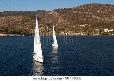 "SARONIC GULF, GREECE - SEPTEMBER 28: Competitors boats during of sailing regatta ""Viva Greece 2012"" on September 28, 2012 on Saronic Gulf, Greece."