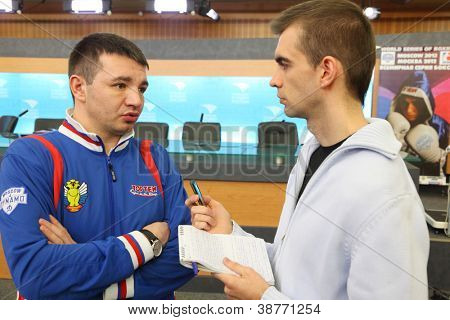 MOSCOW - JAN 12: E.Kravcov trainer of Moscow Dynamo of World Series of Boxing give interview in Press Center RTR, Jan 12, 2012, Moscow, Russia. Matches will be broadcast main channels of 12 countries.
