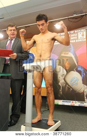 MOSCOW - JAN 12: Weighing underwear boxer on press conference of World Series of Boxing between Dynamo Moscow-Bangkok Elephants in Press Center RTR on Jan 12, 2012 in Moscow, Russia.