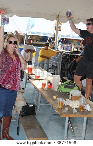 TULSA, OK - OCT 20: Party goers drink beer and sing songs at Oktoberfest in TULSA, OK, on October 20, 2012 in TULSA, OK.  Tulsa is the origin of the Chicken Dance now so popular at the Oktoberfest.
