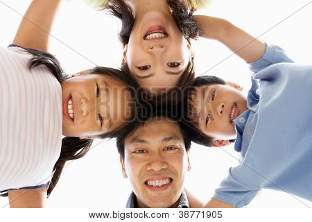Young Chinese Family Looking Down Into Camera