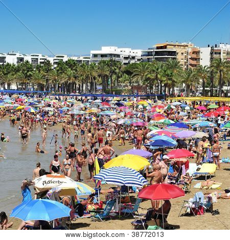 SALOU, SPAIN - AUGUST 10: Vacationers in Llevant Beach on August 10, 2012 in Salou, Spain. Salou is a major destination for sun and beach for European tourism with more than 50,000 accommodations