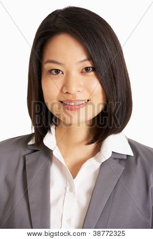 Studio Portrait Of Chinese Businesswoman