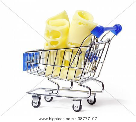 Two appetizing pieces of yellow cheese in shopping cart isolated on white background.