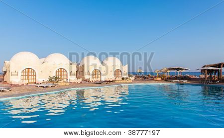 Bungalows and a swimming pool in Dahab, Egypt.