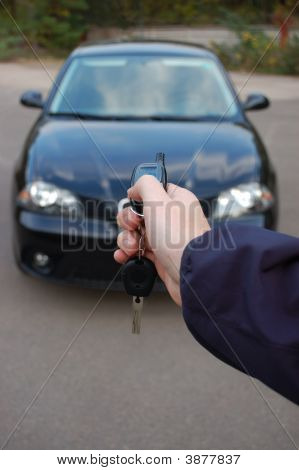 Car Safeguard. Man Hand With Alarm Key Ring