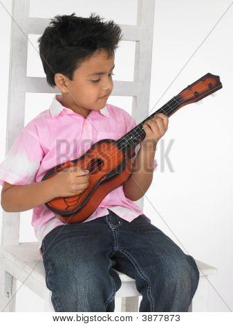 Asian Boy Playing A Guitar