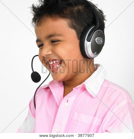 Boy Of Indian Origin With His Headphones