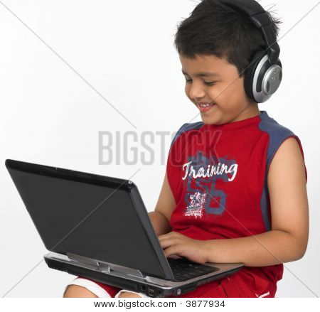 Boy Working On His Laptop