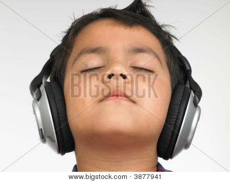 Asian Boy Of Indian Origin Enjoying Music