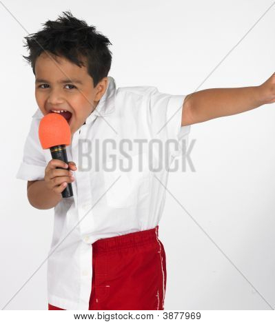 A Cute Asian Indian Boy Of Indian Origin Singing Song