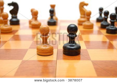 Vintage Chessmen On Chess Board. White Pawn Against Black One.