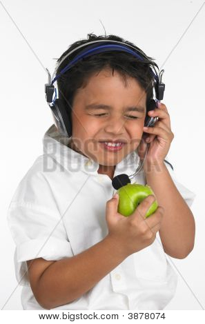 Asian Boy Eating A Green Apple
