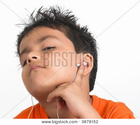 Asian Boy Of Indian Origin Listening To Music
