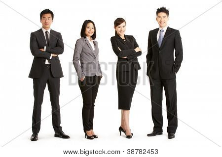 Full Length Studio Portrait Of Chinese Business Team