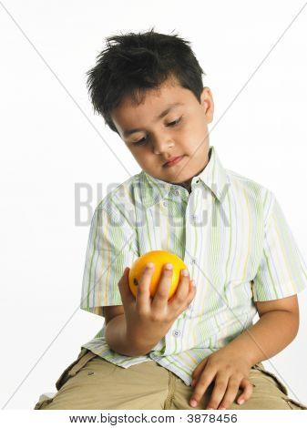 Asian Boy Holding A Yellow Orange