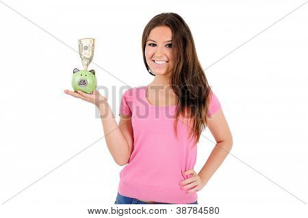 Isolated young casual woman holding piggy