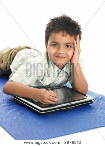 Asian School Boy With His Laptop
