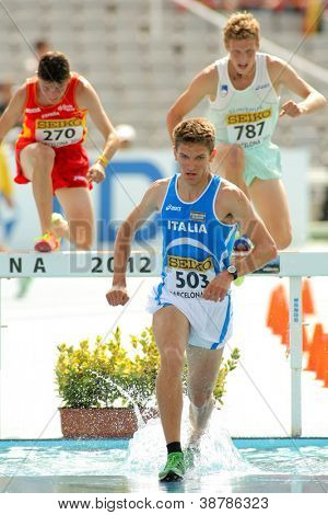BARCELONA - JULY, 13: Italo Quazzola of Italy during 3000m steeplechase event the 20th World Junior Athletics Championships at the Olympic Stadium on July 13, 2012 in Barcelona, Spain