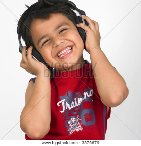 Boy Enjoying Music With His Headphones On
