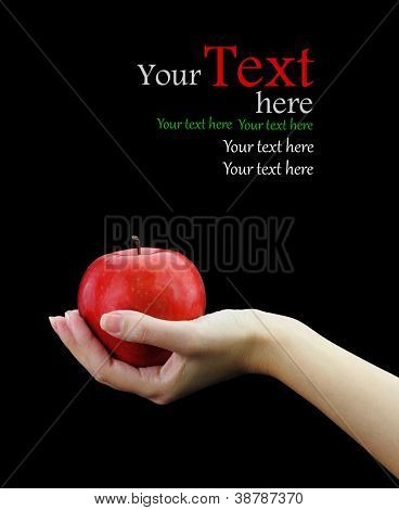 Female hand holding fresh apple