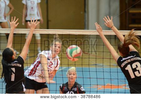 KAPOSVAR, HUNGARY - OCTOBER 7: Zsanett Pinter (in white) in action at the Hungarian I. League volleyball game Kaposvar (white) vs Veszprem (black), october 7, 2012 in Kaposvar, Hungary.