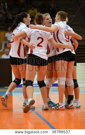 KAPOSVAR, HUNGARY - OCTOBER 7: Kaposvar players celebrate at the Hungarian I. League volleyball game Kaposvar (white) vs Veszprem (black), october 7, 2012 in Kaposvar, Hungary.
