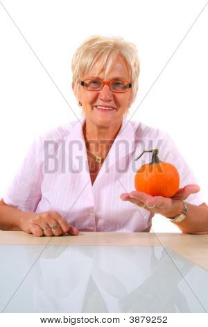 A Senior Woman With A Pumpkin
