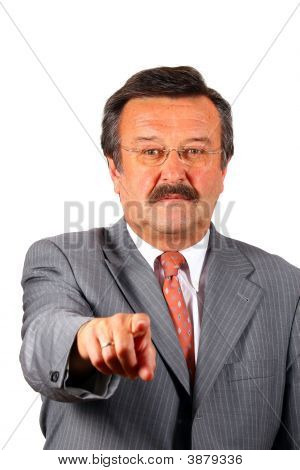Senior Business Man Pointing At The Camera