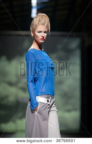 ZAGREB, CROATIA - OCTOBER 10: Fashion model wears clothes made by Marina Design on 'Fashion.hr' show, on October 10, 2012 in Zagreb, Croatia.