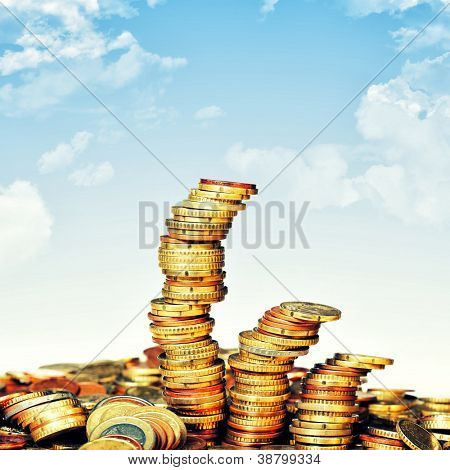euro coin piles and blue sky