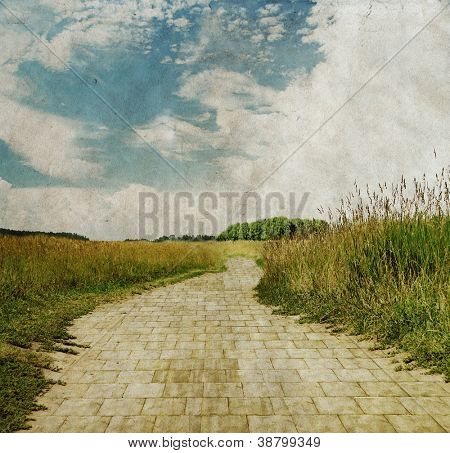 yellow brick road through green meadows, old fantasy grungy illustration