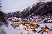 picture of chalet  - Night view of village in mountains - JPG