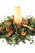 stock photo of christmas flower  - A Christmas flower table decoration with candle - JPG