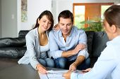 picture of blueprints  - Couple meeting consultant for financial contract - JPG