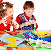 stock photo of scissors  - Children making card - JPG