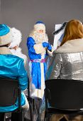 santa claus is conducting a business training