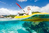 Mother and son kayaking in a tropical lagoon