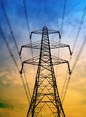 picture of electricity pylon  - Silhouette of electricity pylon with blue and yellow sky - JPG