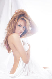 image of nu  - Fashion image of young and sexy redhead woman in white lingerie - JPG