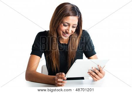 Attractive young Asian Indian teenage woman, working with a non-branded generic portable tablet