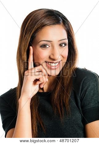 Beautiful young Indian model posing with hand on her face