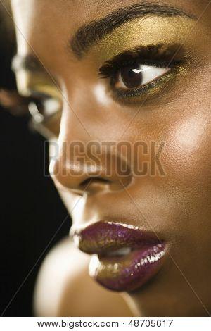 Closeup of an African American woman with highfashion makeup