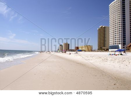 Beach Lined with Condos on One Side and The Ocean on The Other Side