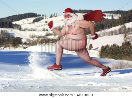 Naked Santa streaks through the snow in winter wonderland.