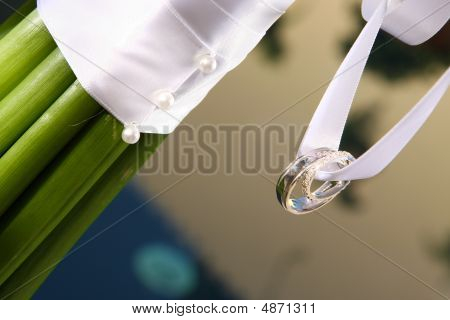 Flower Bouquet And Wedding Rings