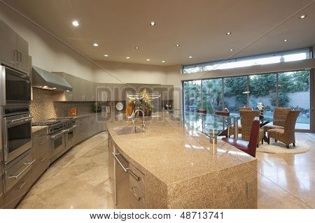 Open plan kitchen with dining area in modern house