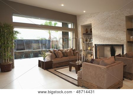 Three piece suite around coffee table in modern house