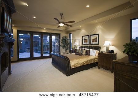 Dark wood furniture in bedroom with ceiling fan