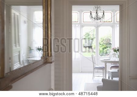 Mirror in hallway with view of living room